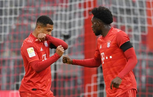 23 May 2020, Bavaria, Munich: Football: Bundesliga, 27th matchday, FC Bayern Munich - Eintracht Frankfurt, in the Allianz Arena. Serge Gnabry and Alphonso Davies (r) of Bayern cheer about the goal for the 5:2. PHOTO | AFP