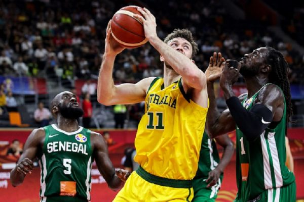 #11 Nic Kay of Australia drives the ball during the 2019 FIBA World Cup, first round match between Australia and Senegal at Dongguan Basketball Center on September 03, 2019 in Dongguan, China.PHOTO/ GETTY IMAGES