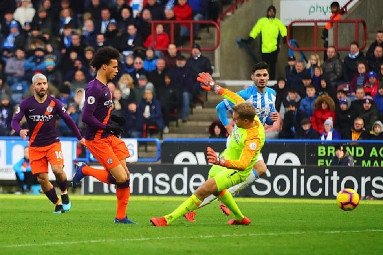 Leroy Sane of Manchester City scores his side's third goal during the Premier League match between Huddersfield Town and Manchester City at John Smith's Stadium on January 20, 2019 in Huddersfield, United Kingdom.PHOTO/GETTY IMAGES