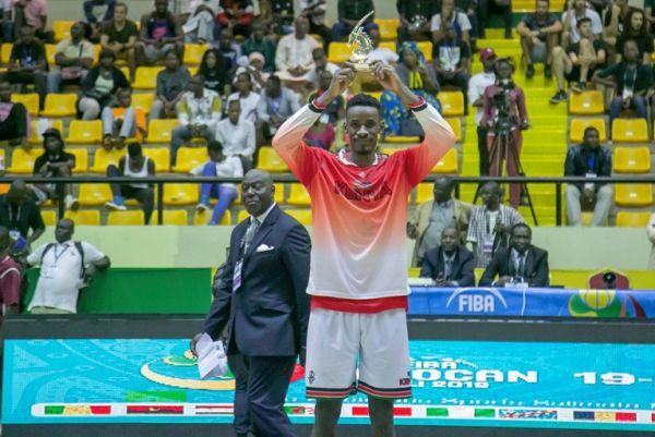 Kenya Morans and Bakken Bears forward Tylor Okari Ongwae with his Top Scorer Award trophy in Bamako, Mali on July 27, 2019. PHOTO/ FIBA.COM