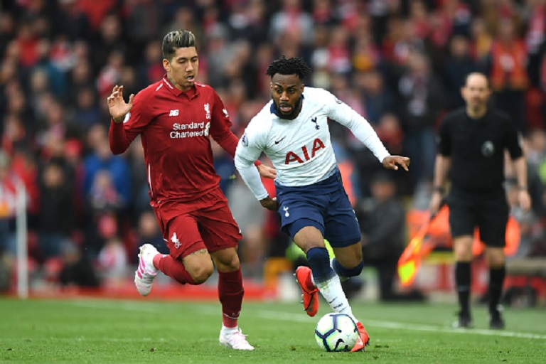 Danny Rose of Tottenham Hotspur is close down by Roberto Firminho of Liverpool during the Premier League match between Liverpool FC and Tottenham Hotspur at Anfield on March 31, 2019 in Liverpool, United Kingdom.PHOTO/ GETTY IMAGES