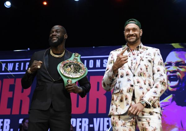 Deontay Wilder (L) and Tyson Fury get together during a news conference at The Novo Theater at L.A. Live on January 13, 2020 in Los Angeles, California. PHOTO | AFP
