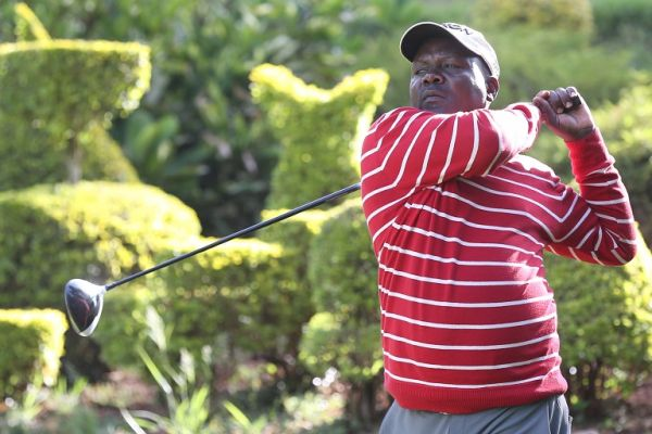 Dismas Indiza follows the flight of his drive at a past event. He is the leading at the ongoing Lake Serena Open in Kampala. PHOTO/ SPN