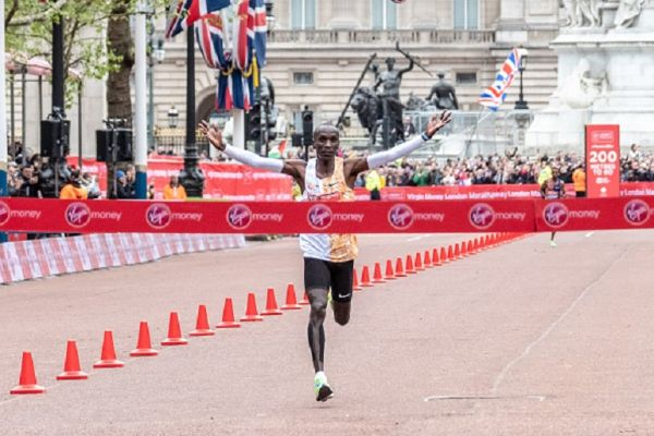 Eliud Kipchoge crosses the finishing line 1st and new course record during the 2019 Virgin Money London Marathon on April 28, 2019 London, England. PHOTO/ GETTY IMAGES