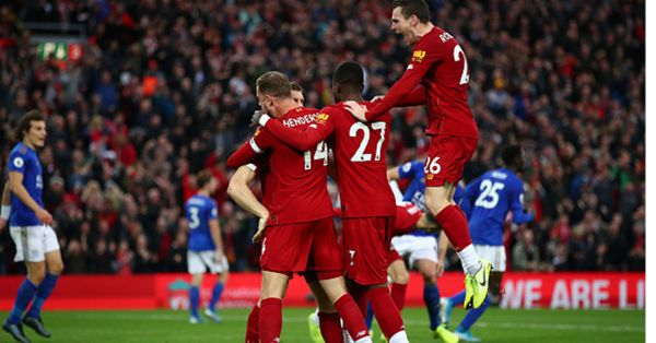 James Milner of Liverpool celebrates with Jordan Henderson of Liverpool and Divock Origi of Liverpool and Andy Robertson of Liverpool after he scores his sides second goal from the penalty spot during the Premier League match between Liverpool FC and Leicester City at Anfield on October 05, 2019 in Liverpool, United Kingdom. PHOTO/ GETTY IMAGES