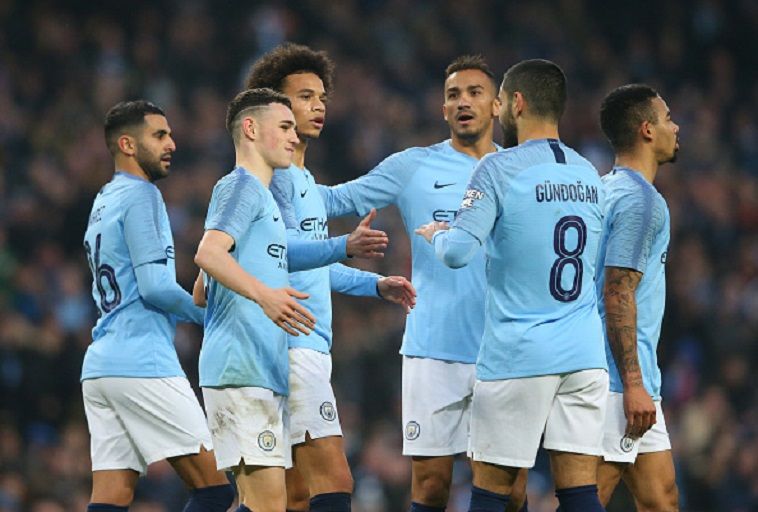 Leroy Sane of Manchester City celebrates with teammates after scoring his team's seventh goal during the FA Cup Third Round match between Manchester City and Rotherham United at the Etihad Stadium on January 6, 2019 in Manchester, United Kingdom. PHOTO/GettyImages