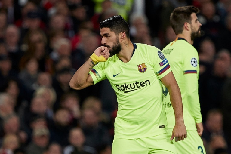 Luis Suarez of FC Barcelona celebrates with team mates after a Luke Shaw own goal puts Barcelona 0-1 up during the UEFA Champions League Quarter Final first leg match between Manchester United and FC Barcelona at Old Trafford on April 10, 2019 in Manchester, England. PHOTO/ GETTY IMAGES