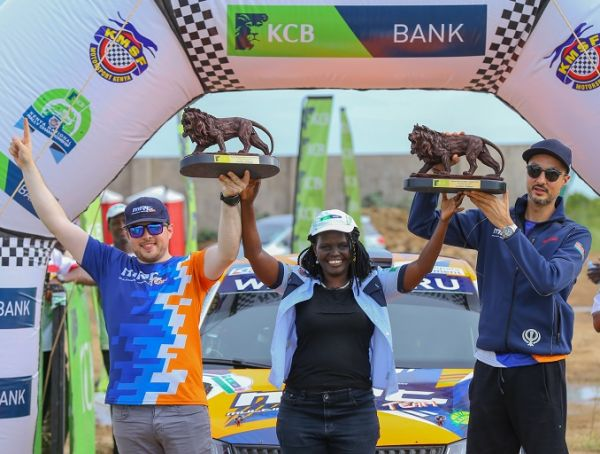(R-L) KCB Kenya National Rally Championship (KNRC) Kilifi winner Manvir Baryan, KCB Regional Business Manager Coast Region Jane Isiaho and Manvir's navigator Drew Sturrock during the fourth round of KCB KNRC prize Giving ceremony at Mombasa Cement, Kilifi.PHOTO/ SPN