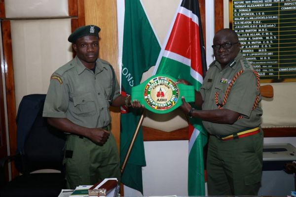Rayton 'Boom Boom' Okwiri  when he presented the coveted ABU belt to Kenya Prisons Service Commissioner General Wycliffe Ogallo in Nairobi on June 27, 2019. PHOTO/ KPS