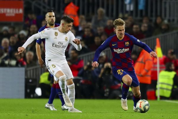 Real Madrid's Brazilian Forward Vinicius Junior (Front L) vies with Barcelona's Dutch midfielder Frekie De Jong (R) during Spanish El Clasico football match between FC Barcelona and Real Madrid at the Camp Nou stadium in Barcelona on December 18, 2019. PHOTO | AFP