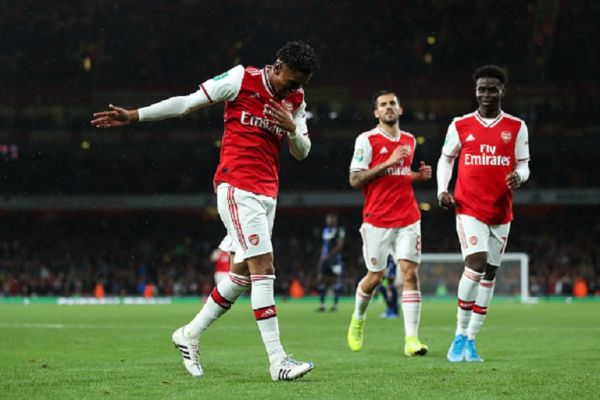 Reiss Nelson of Arsenal celebrates after scoring a goal to make it 4-0 during the Carabao Cup Third Round match between Arsenal and Nottingham Forest at Emirates Stadium on September 24, 2019 in London, England.PHOTO/ GETTY IMAGES