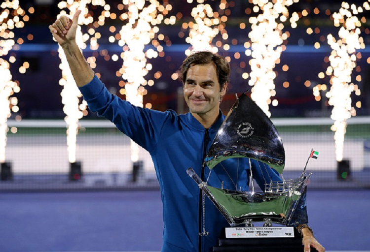 Roger Federer of Switzerland poses with the winners trophy after victory during day fourteen of the Dubai Duty Free Championships at Tennis Stadium on March 02, 2019 in Dubai, United Arab Emirates. PHOTO/GettyImages