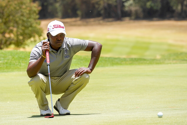 Thika Golf Club's Simon Ngige lines up a putt on the final round of the 2019 Magical Kenya Open Golf Championship. He finished the tournament with a 5-under par score to tie in 25th. PHOTO/Courtesy