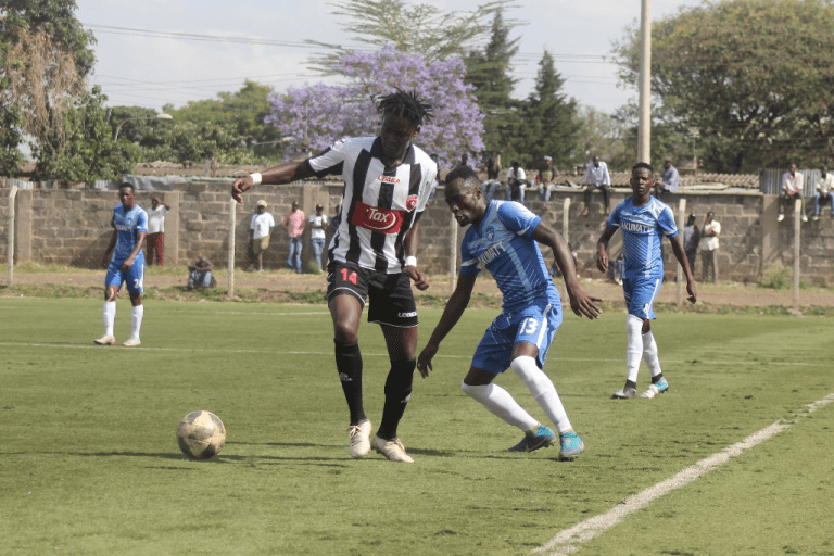 Ushuru forward Bill Oporia is closely kept in check by Nakumatt's Cornelius Juma during the first leg of the 2018 KPL Promotion playoff played on Friday October 19, 2018, at Camp Toyoyo.PHOTO/FKF