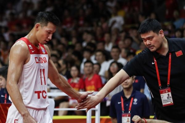 Yao Ming (R), chairman of the Chinese Basketball Association, claps hands with Yi Jianlian of China during the group M match between China and Nigeria at the 2019 FIBA World Cup in Guangzhou, south China's Guangdong Province, Sept. 8, 2019. PHOTO | AFP