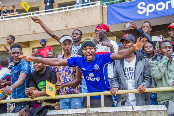 A local Everton FC supporter in a throwback jersey cheers the English Premier League side when they played Kariobbangi Sharks FC in an international friendly at the MISC Kasarani on Sunday, July 7, 2019. PHOTO/SPN