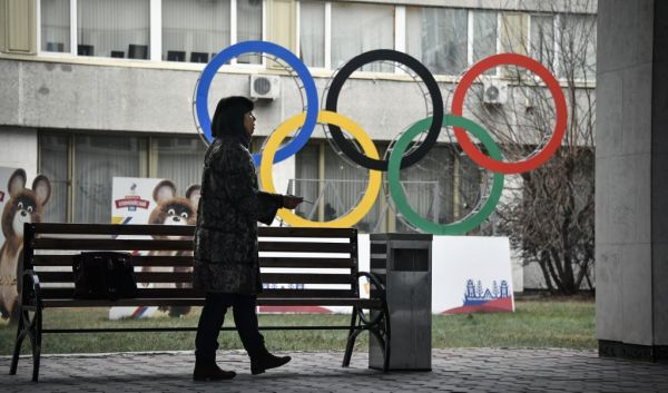 A woman smokes in front of the Russian Olympic Committee (ROC) headquarters in Moscow on November 26, 2019. Russia's anti-doping chief said on November 26, 2019 he expected the country to be barred from all sporting competition for four years, after a bombshell recommendation from the World Anti-Doping Agency that shocked Russian athletes. WADA's Compliance Review Committee recommended the ban on Monday, accusing Moscow of falsifying laboratory data handed over to investigators. It recommended Russia also face a four-year ban from staging or bidding for major international sporting events -- potentially putting Saint Petersburg's status as a venue for the Euro 2020 football tournament in jeopardy. PHOTO | AFP
