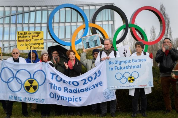 Activists stage a protest in front of the headquarters of the International Olympic Committee (IOC) against the holding of the Tokyo 2020 Olympic Games under the state of nuclear emergency, on February 26, 2020, in Lausanne. PHOTO | AFP