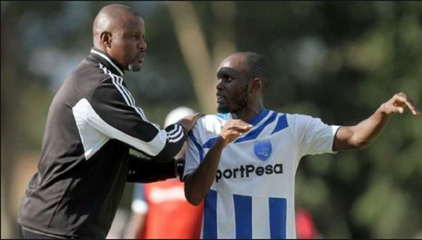 AFC Leopards SC coach Andre Casa Mbungo and midfielder Whyvonne Isuza. PHOTO | NairobiNews