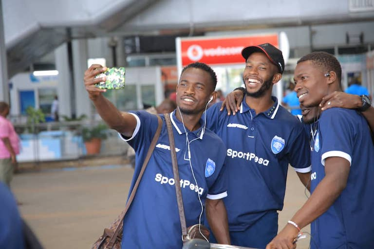 AFC Leopards SC players, (L to R) Yusuf Mainge, Moses Mburu and Jaffery Owiti could not resist taking a selfie upon landing at the Julius Nyerere International Airport on Saturday, January 19, 2019 for the SportPesa Cup showdown. PHOTO/SPN