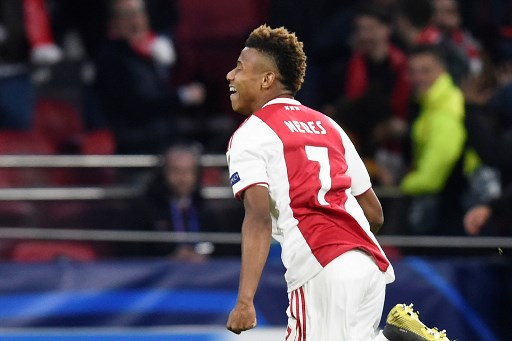 Ajax's Brazilian forward David Neres celebrates after scoring a goal during the UEFA Champions League first leg quarter-final football match between Ajax Amsterdam and Juventus FC at the Johan Cruijff ArenA in Amsterdam on April 10, 2019. PHOTO/AFP