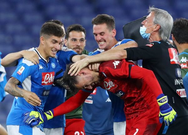 Alex Meret of Napoli celebrates with Arkadiusz Milik, Eljif Elmas, Piotr Zielinski, Giovanni Di Lorenzo and Dries Mertens after the penalties kicked at the end of the Coca Cola Italian Cup Final football match SSC Napoli v Fc Juventus at the Olimpico Stadium in Rome, Italy on June 17, 2020. PHOTO | AFP