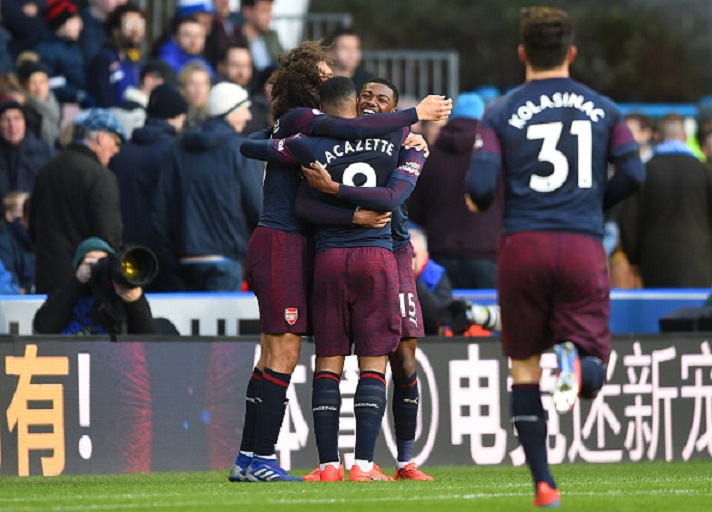 Alexandre Lacazette of Arsenal celebrates with teammates after scoring his team's second goal during the Premier League match between Huddersfield Town and Arsenal FC at John Smith's Stadium on February 09, 2019 in Huddersfield, United Kingdom. PHOTO/GettyImages