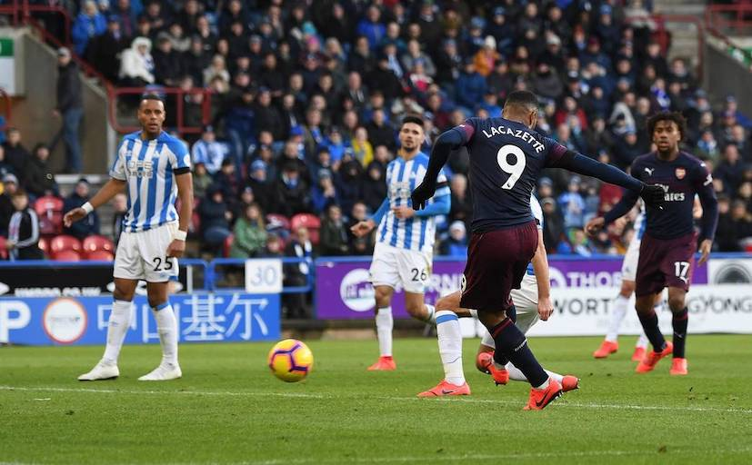 Alexandre Lacazette shoots to extend Arsenal FC's lead in their 2-1 victory at Huddersfield Town FC on Saturday, February 8, 2019. PHOTO/Arsenal FC