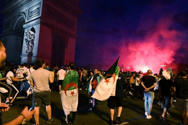 Algerian supporters celebrate near the Arc de Triomphe in Paris after the victory of their team during the 2019 Africa Cup of Nations (CAN) quarter final football match between Ivory Coast and Algeria, on July 11, 2019. PHOTO | AFP
