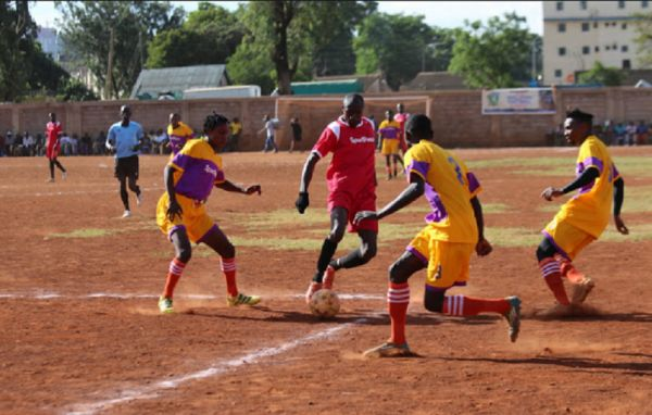 Allin Jua Kali FC in action at the 2019 Koth Biro tournament in Ziwani, Nairobi. PHOTO | The Star
