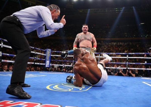 Andy Ruiz Jr knocks down Anthony Joshua in the third round during their IBF/WBA/WBO heavyweight title fight at Madison Square Garden on June 01, 2019 in New York City. PHOTO/AFP