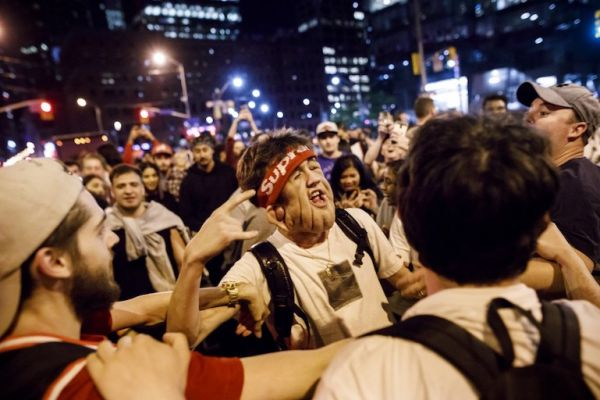 ans react to a Toronto Raptors win in the streets of Toronto as Raptors fans gather to watch Game 4 of the NBA Finals series outside Scotiabank Arena at 'Jurassic Park', on June 7, 2019 in Toronto, Canada. PHOTO/AFP
