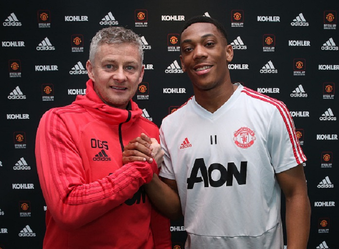 Anthony Martial poses with Caretaker Manager Ole Gunnar Solskjaer after signing an extension to his contract at Aon Training Complex on January 31, 2019 in Manchester, England. PHOTO/GettyImages
