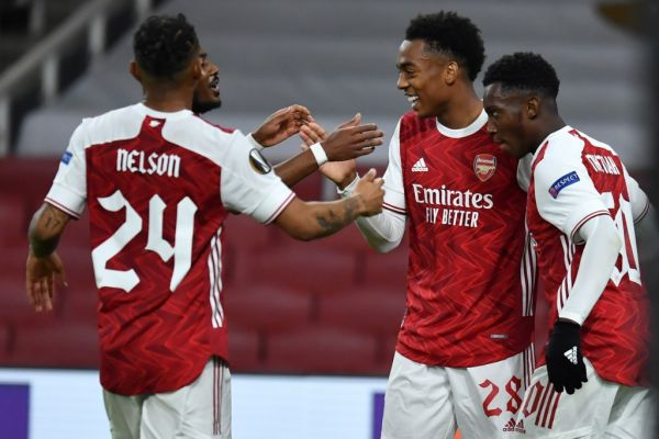 Arsenal's English midfielder Joe Willock (2R) celebrates with teammates after he scores his team's second goal during the UEFA Europa League 1st round day 2 Group B football match between Arsenal and Dundalk at the Emirates Stadium in London on October 29, 2020. PHOTO | AFP