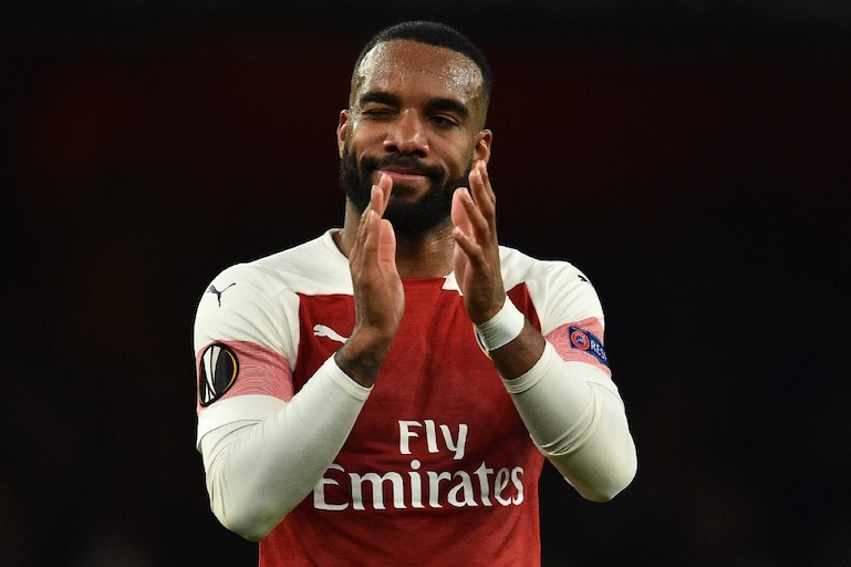 Arsenal's French striker Alexandre Lacazette applauds supporters on the pitch after the UEFA Europa League semi final, first leg, football match between Arsenal and Valencia at the Emirates Stadium in London on May 2, 2019. Arsenal won the game 3-1. PHOTO/AFP