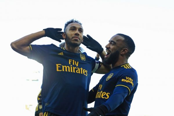 Arsenal's Gabonese striker Pierre-Emerick Aubameyang (L) celebrates with Arsenal's French striker Alexandre Lacazette (R) after scoring their first goal from the penalty spot during the English Premier League football match between Norwich City and Arsenal at Carrow Road in Norwich, eastern England on December 1, 2019. PHOTO | AFP