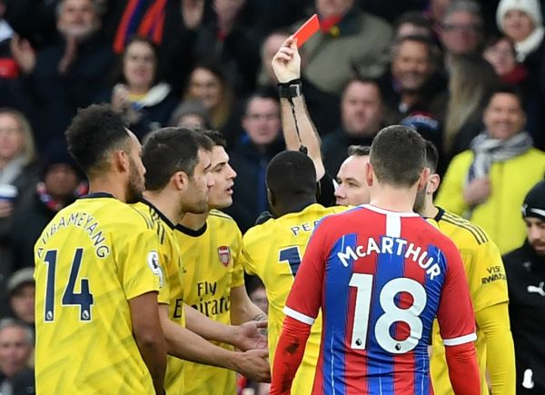 Arsenal's Gabonese striker Pierre-Emerick Aubameyang (L) is given a red card during the English Premier League football match between Crystal Palace and Arsenal at Selhurst Park in south London on January 11, 2020. PHOTO | AFP