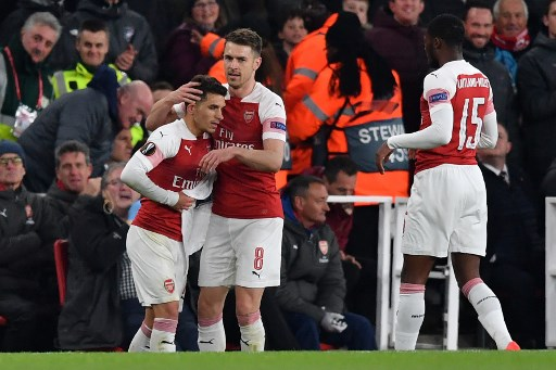 Arsenal's Uruguayan midfielder Lucas Torreira (L) celebrates with Arsenal's Welsh midfielder Aaron Ramsey after scoring the team's second goal during the UEFA Europa League quarter final, first leg, football match between Arsenal and Napoli at the Emirates Stadium in London on April 11, 2019. PHOTO/AFP