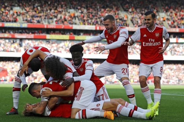 Asenal's Brazilian defender David Luiz (C) celebrates with teammates after scoring the opening goal of the English Premier League football match between Arsenal and Bournemouth at the Emirates Stadium in London on October 6, 2019. PHOTO | AFP