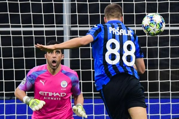 Atalanta's Croatian midfielder Mario Pasalic (R) scores a header past Manchester City's Chilean goalkeeper Claudio Bravo to equalize during the UEFA Champions League Group C football match Atalanta Bergamo vs Manchester City on November 6, 2019 at the San Siro stadium in Milan. PHOTO | AFP