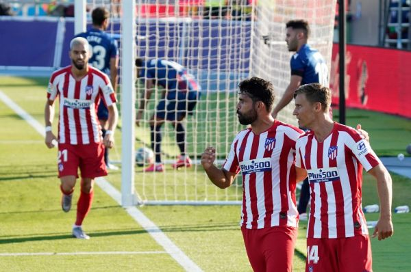 Atletico Madrid's Spanish forward Diego Costa (C) celebrates with Atletico Madrid's Spanish midfielder Marcos Llorente after scoring during the Spanish league football match Levante UD against Club Atletico de Madrid at the Camilo Cano stadium in La Nucia on June 23, 2020. PHOTO | AFP