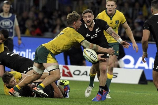 Australia's captain Michael Hooper (L) tackles New Zealand's T J Perenara during the Rugby Championship Bledisloe Cup Test match between the Australian Wallabies and New Zealand All Blacks in Perth on August 10, 2019. PHOTO | AFP