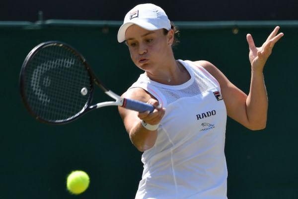 Australia's Ashleigh Barty returns against Belgium's Alison van Uytvanck during their women's singles second round match on the fourth day of the 2019 Wimbledon Championships at The All England Lawn Tennis Club in Wimbledon, southwest London, on July 4, 2019. PHOTO/AFP