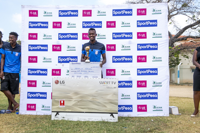 Bandari FC midfielder, Abdallah Hassan poses with his KSh100,000 dummy cheque, trophy and 49-inch LG Smart TV after being crowned the SportPesa/SJAK Player of the Month for January at the Mbaraki Sports Club, Mombasa on February 26, 2019. PHOTO/Duncan Sirma/SPN