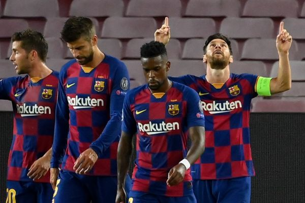 Barcelona's Argentine forward Lionel Messi (R) celebrates with teammates after scoring a goal during the UEFA Champions League round of 16 second leg football match between FC Barcelona and Napoli at the Camp Nou stadium in Barcelona on August 8, 2020. PHOTO | AFP
