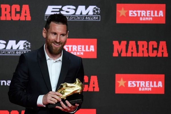 Barcelona's Argentinian forward Lionel Messi poses with his sixth Golden Shoe award after receiving the 2019 European Golden Shoe honoring the year's leading goalscorer during a ceremony at the Antigua Fabrica Estrella Damm in Barcelona on October 16, 2019. PHOTO | AFP