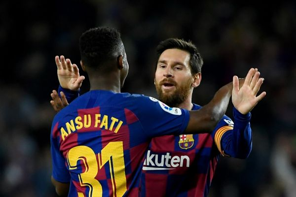 Barcelona's Guinea-Bissau forward Ansu Fati (L) celebrates with Barcelona's Argentine forward Lionel Messi after scoring during the Spanish league football match be tween FC Barcelona and Levante UD at the Camp Nou stadium in Barcelona, on February 2, 2020. PHOTO | AFP