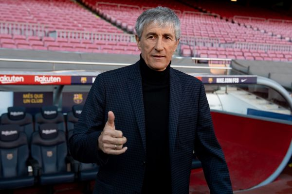 Barcelona's new coach Quique Setien poses for a photo during his official presentation at the Camp Nou stadium in Barcelona on January 14, 2020, after signing his new contract with the Catalan club. PHOTO | AFP