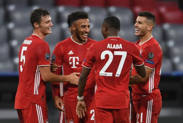 Bayern Munich's French midfielder Corentin Tolisso (2nd L) celebrates scoring the 3-0 goal with his team-mates during the UEFA Champions League Group A football match FC Bayern Munich v Atletico Madrid in Munich, southern Germany on October 21, 2020. PHOTO | AFP