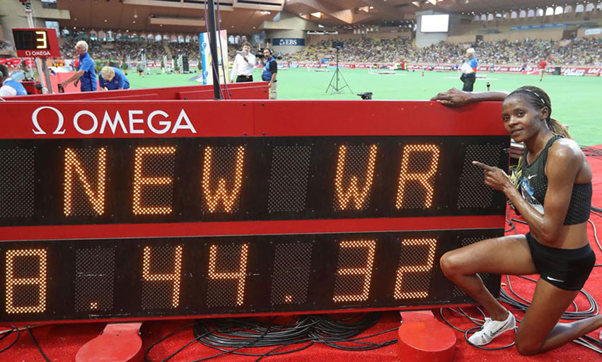 Beatrice Chepkoech poses next to the clock displaying her new world record in the 3000m steeplechase women at the 2018 IAAF Diamond League meeting in Monaco. PHOTO/File